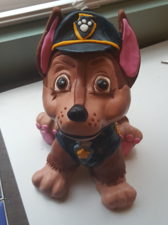 Closeup of Chase Paw Patrol cake topper